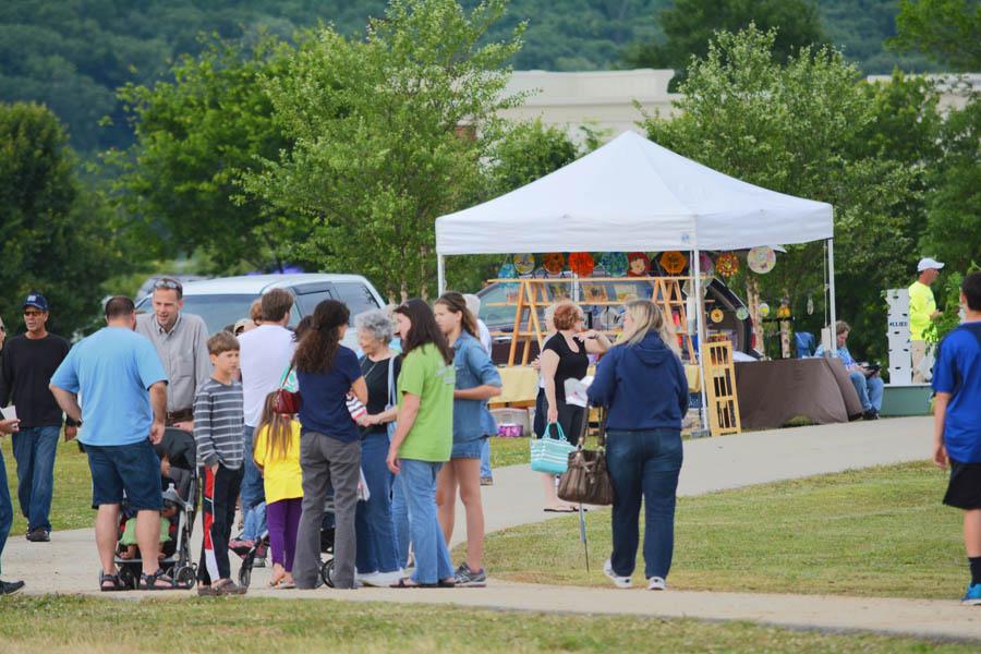 Families Meet Near a Vendors Tent