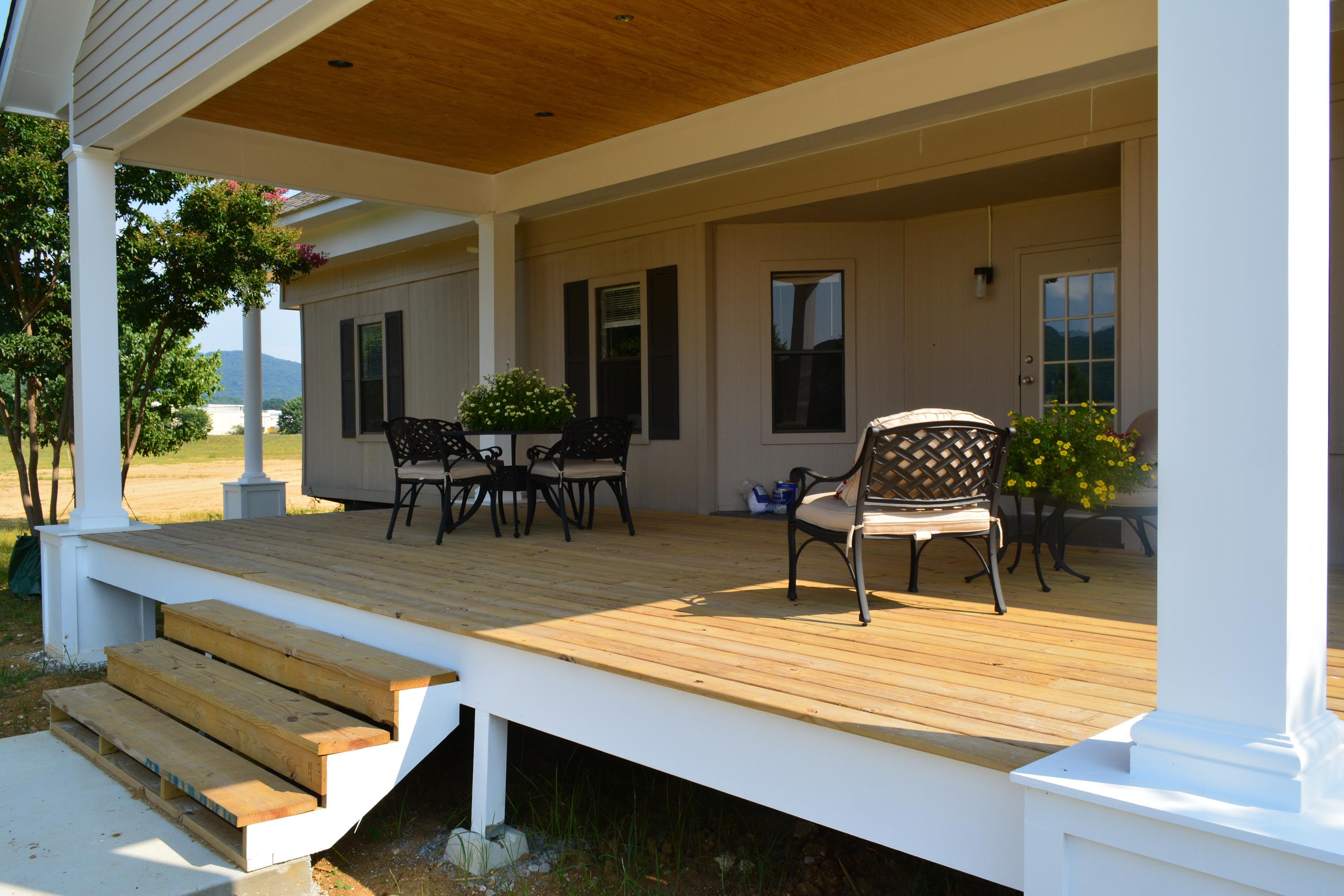 Come rest your feet on our Welcome Center's new Front Porch