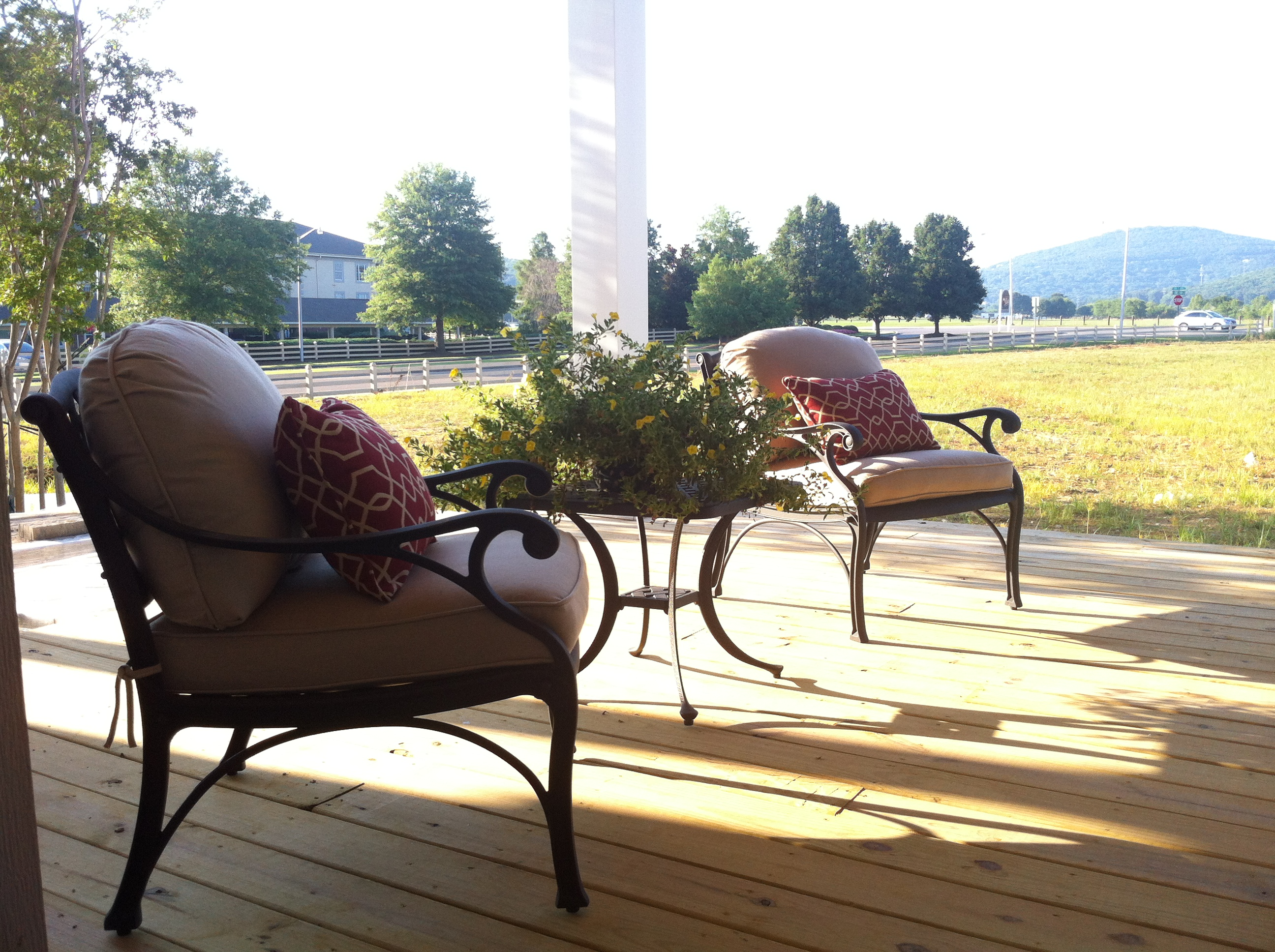 There's a chair on our Welcome Center's Front Porch just waiting for YOU!