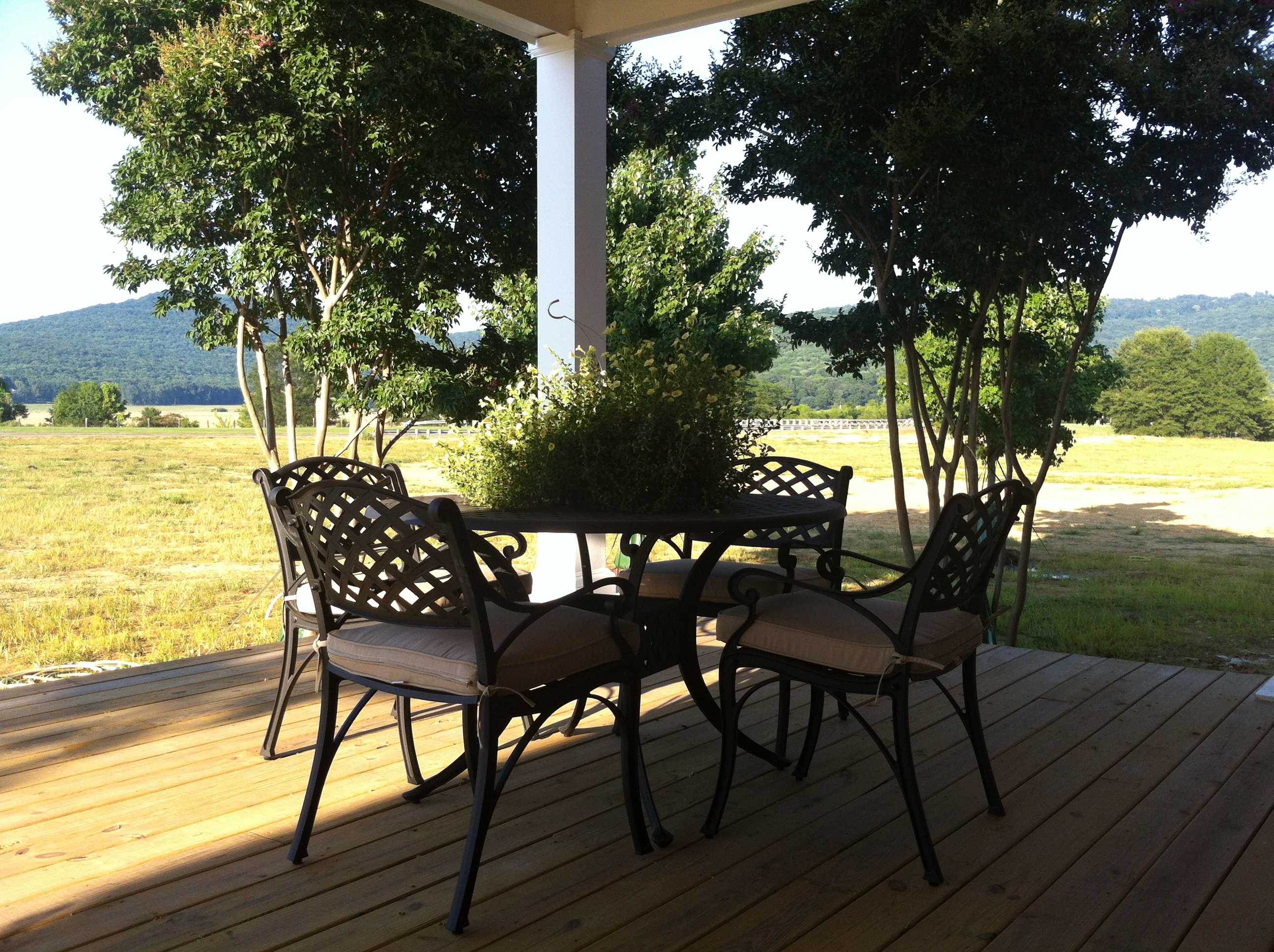 Find some shade, pull up a seat, and chat on our Welcome Center's new Front Porch