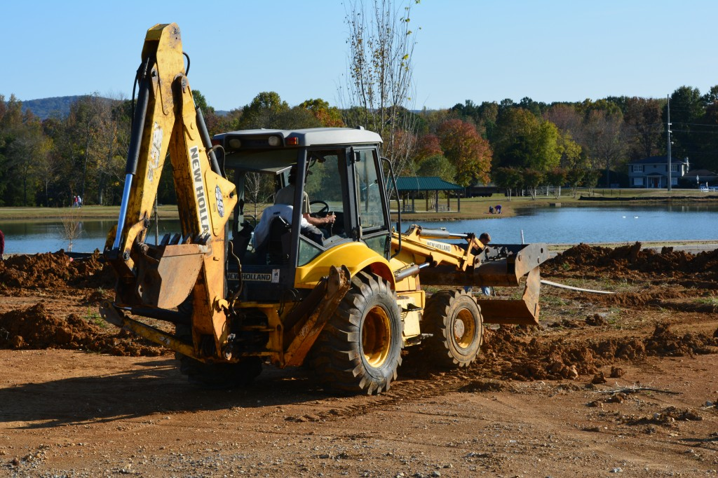 11. A Backhoe readies the ground for another new LENDON Home, while enjoying a beautiful view of Jones Farm Park. _0806