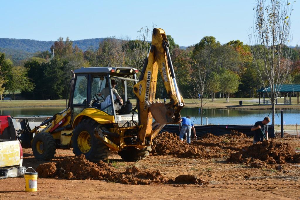 13. A crew preps a newly dug foundation near Jones Farm Park ._0803